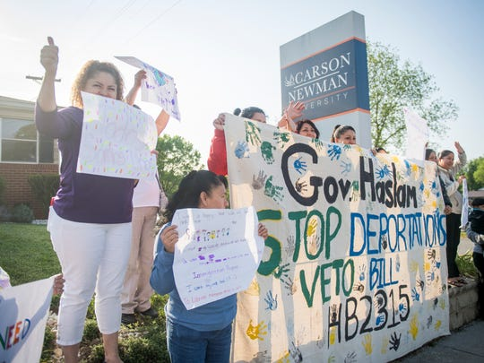 Family and friends of workers arrested in the ICE raid at the Southeastern Provision meat-packing plant in Bean Station demonstrate against immigration crackdowns in Jefferson City on May 4, 2018.