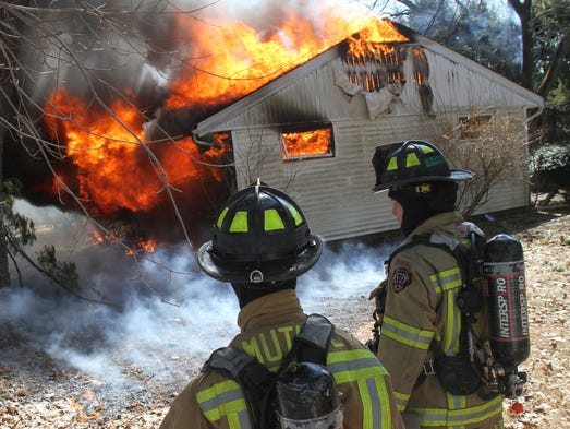Mount Kisco firefighters prepare to attack a fully engulfed house fire at 3 Circle Drive in the Town of New Castle March 24, 2014.