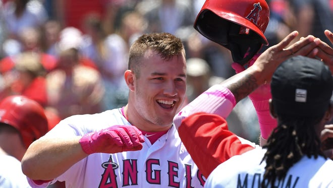 Mike Trout of the Angels is greeted in the dugout after a solo home run in the first inning against the Tigers at Angel Stadium of Anaheim on May 14, 2017 in Anaheim, Calif.