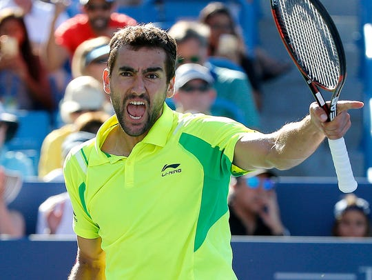Marin Cilic celebrates after beating Andy Murray, 6-4,