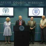 Greene County Presiding Commissioner Bob Cirtin, center, along with other county officials, speaks at a press conference in May.