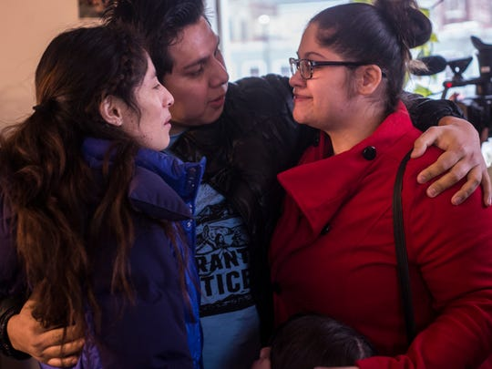 From left,  Zully Palacios, Enrique Balcazar and Lymarie Deida embrace before a news conference at the Vermont Workers Center in Burlington, Vt., on Tuesday night, March 28, 2017. Palacios and Balcazar, both arrested by ICE along with Deida's husband Alex Carrillo, were released on bail. Carrillo remains in federal detention.