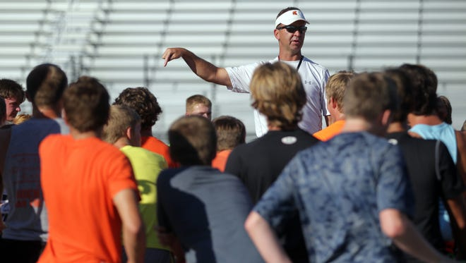 Solon head coach Kevin Miller gathers his team for camp on Monday, Aug. 3, 2015.