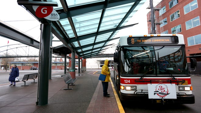 A passenger boards a bus in Salem on Monday, Jan. 4, 2016. Cherriots is considering renewing its long-absentSaturday, holiday and evening bus services,adding Sunday routes for the first time and implementing a downtown circulator bus.