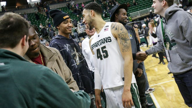 Michigan State captain Denzel Valentine (45) talks with former player Gary Harris at the Breslin Center in East Lansing on Sunday, Feb. 14, 2016.