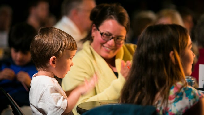 Erica Wiggins of Fairfax and her son James, 4, clap along to the Marcus Roberts Trio during a Junior Jazz matinee show for Burlington Discover Jazz Festival on Friday, June 10 2016 at FlynnSpace in Burlington, Vermont.