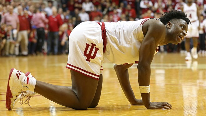 Indiana Hoosiers forward OG Anunoby (3) grimaces after twisting his ankle coming down from a dunk during second half action between the Indiana Hoosiers and the North Carolina Tar Heels at Assembly Hall, Bloomington, Ind., Wednesday, Nov. 30, 2016. Anunoby was out for the remainder of gameplay.