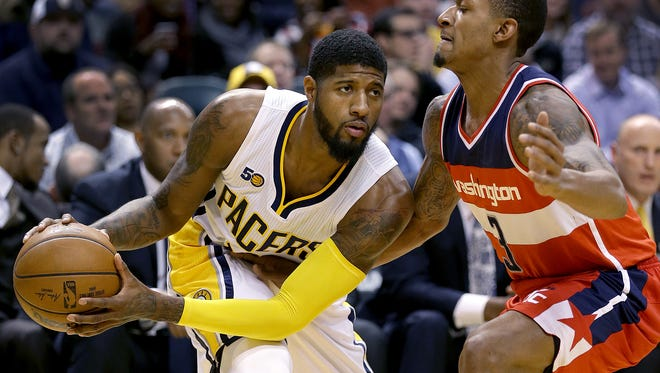 FILE -- Indiana Pacers forward Paul George (13) looks to put a move on Washington Wizards guard Bradley Beal (3) in the first half of their game Monday, December 19, 2016, evening at Bankers Life Fieldhouse.