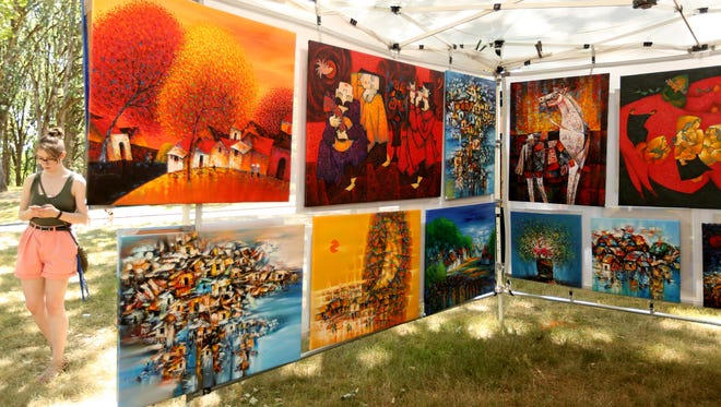 Paintings by Hung Pham, of Seattle, Wash., at the Salem Art Fair & Festival at Bush's Pasture Park on Saturday, July 22, 2017.