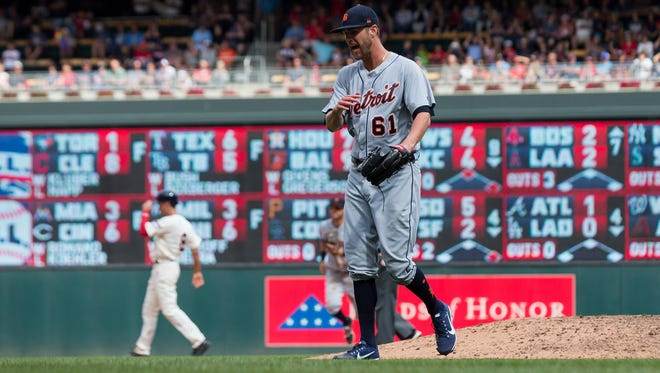Tigers pitcher Shane Greene (61) reacts in the seventh inning of the Tigers' 9-6 win on Sunday, July 23, 2017, in Minneapolis.
