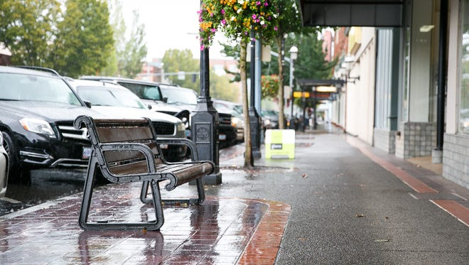 A bench outside of women's boutique Olivia's is a common congregating point for homeless people in Downtown Salem on Wednesday, Sept. 20, 2017. Story owner Sandy Powell said she faces a dilemma when it comes to the ordinance being considered by the city that will ban sitting or lying on the sidewalks from 7am to 9pm; the men who congregate on and around benches outside her store are largely polite and courteous, but customers have still voiced concerns about feeling unsafe or uncomfortable.