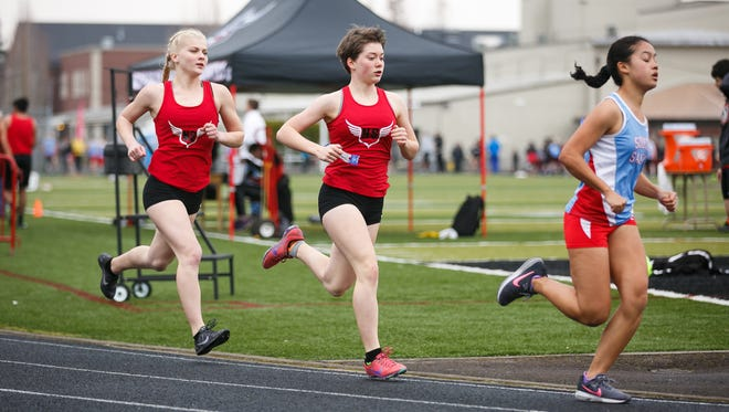 North Salem senior Madison Willhoft, left, and sophomore Abigail Swain, center, run the 1,500-meter at a dual meet against South Salem on Wednesday, March 21, 2018, at North Salem High School. South Salem junior Anna Chau won the race, followed by Swain and Willhoft.
