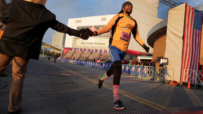 James Holly Jr. of Lafayette, Ind. finishes the 10K during the 2014 Fifth Third Bank Turkey Trot.