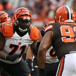 Cincinnati Bengals offensive tackle Andre Smith (71) gets set to block against Cleveland Browns defensive end John Hughes (93) during the first half of a Dec. 6, 2015, game in Cleveland. Smith, a free agent, agreed to terms on a one-year deal with the Minnesota Vikings.