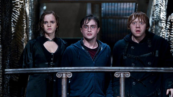 Emma Watson, Daniel Radcliffe and Rupert Grint in 'Harry
