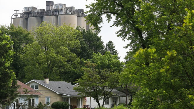 Behind a row of homes on Indiana Avenue in Speed is the former Essroc - now Lehigh Hanson- cement plant. There are dozens of homes as well as the Silver Creek High School, middle school and elementary school nearby.