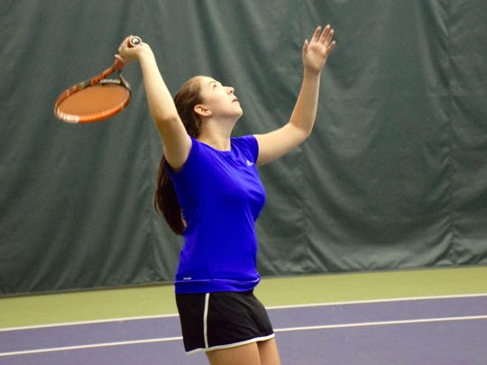 Abby Aleshevich hits a serve during a ju ior mixed