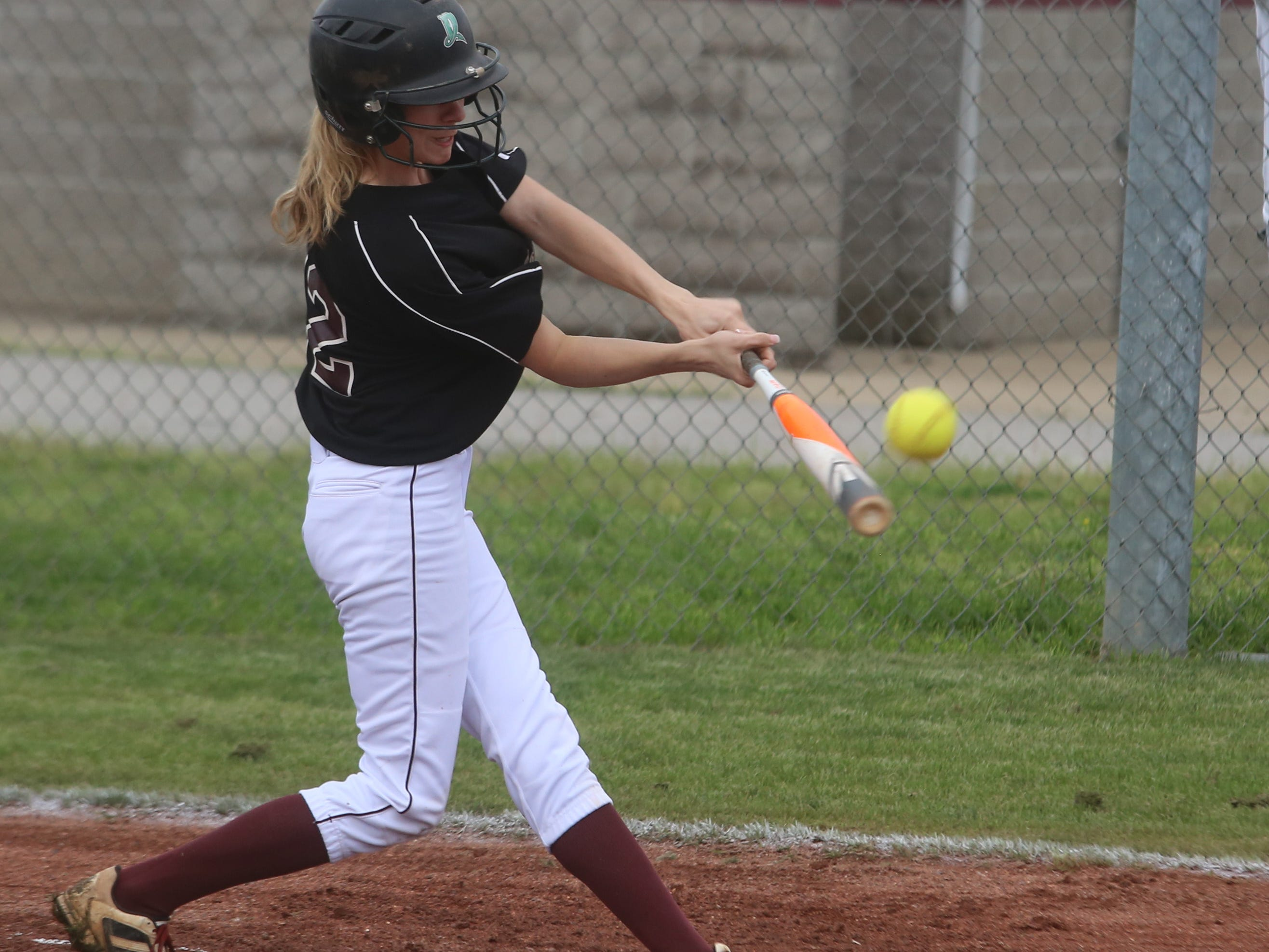 Eagleville leadoff hitter Kelsey Burks makes contact in the first inning of the Lady Eagles' 23-0 win over MTCS on Friday.