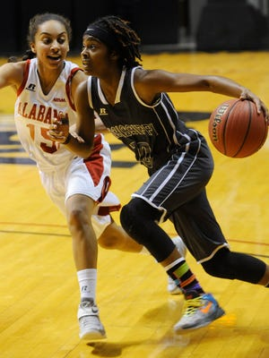 Jazzmun Holmes is defended by Alabama All-Star Jada Smith during the Alabama-Mississippi All-Star Classic at the Acadome on Friday.