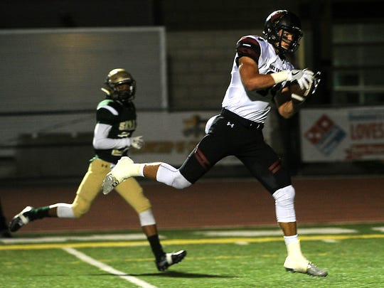 Oaks Christian's Colby Parkinson makes the catch for a touchdown in the first quarter of Friday night's game against St. Bonaventure at Ventura High.