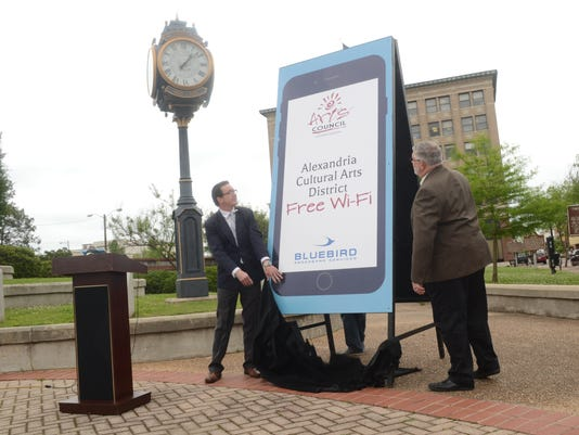 ANI Free WiFi in downtown Alexandria Matt Henry (left), executive director of the Arts Council of Central Louisiana, and Tony Downs, general manager of Bluebird Broadband, announce that free Wi-Fi is now available in downtown Alexandria Tuesday, April 28,