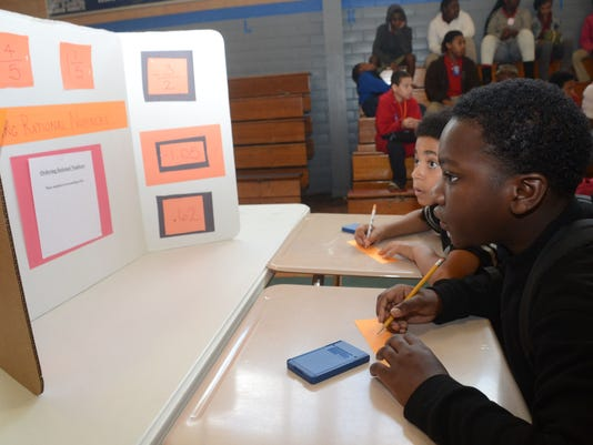 ANI Math Madness Alexandria Middle Magnet School students Tobias Hall (front) and Reginald Pullins work on math problems during the school's Math Madness competition held Friday, March 13, 2015.-Melinda Martinez/mmartinez@thetowntalk.com