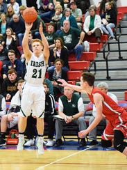 Fisher Catholic's Zach Saffell shoots a 3-pointer against