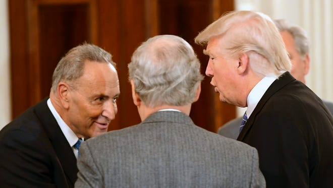 President Trump welcomes Senate Minority Leader Chuck Schumer, D-N.Y., far left, and Majority Leader Mitch McConnell, R-Ky., as he hosts a reception for congressional leaders at the White House in January.