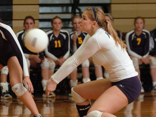 Port Huron Northern's  Rachel Kolar digs for a bump to opponent St. Clair, in 2011 Class A volleyball action at L'Anse Creuse High School.