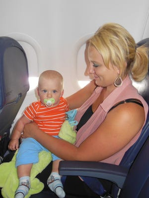 Agatha Jarosz of South Lyon has been all over the world with her son Adrian. Here they are on a plane to Myrtle Beach, S.C.
