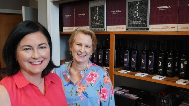 Entrepreneurs Gayle Corrigan and Linda Dykeman at their Pawtucket headquarters for Saperavi USA. They have a full warehouse of wine that arrived on March 11 from Georgia before the shutdown due to COVID-19. [The Providence Journal / Sandor Bodo]
