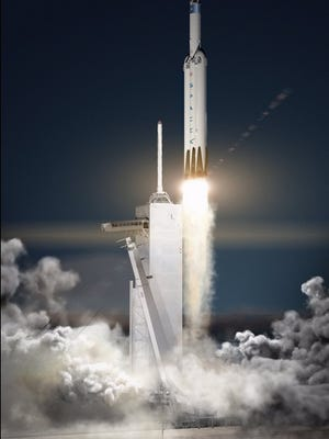 "Concept image of a Falcon Heavy rocket launching a ""Red Dragon"" spacecraft to Mars."