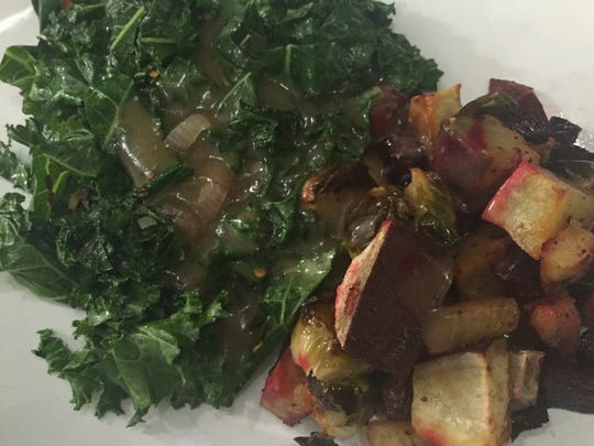 Three Carrots chef Ian Phillips uses Marmite, a brand of yeast extract to give braised kale rich flavor alongside roasted root vegetables.