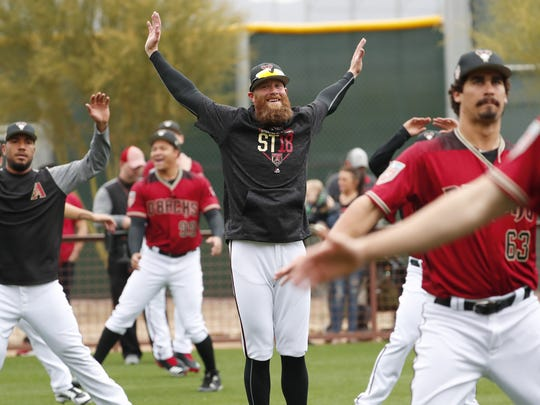 Diamondbacks reliever Archie Bradley warms up during the first day of workouts on Wednesday.