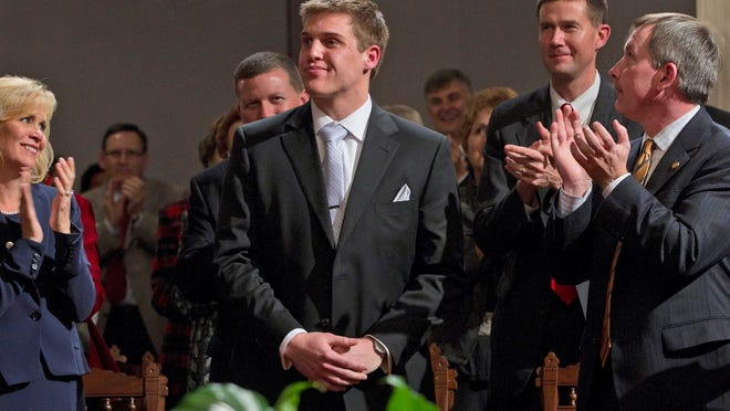 Former Alabama football player Carson Tinker, center, is honored by Gov. Robert Bentley, not shown, during his 2012 State of the State address in Montgomery.