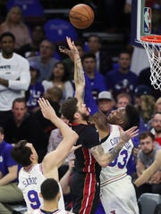 Sixers forward Robert Covington (33) stymies Miami's Tyler Johnson in the first half of the Sixers' 130-103 win in the opening game of the first round of the NBA playoffs at the Wells Fargo Center Saturday.