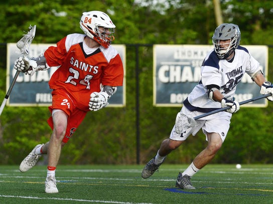 Churchville-Chili's Jacob Buck, left, is defended by