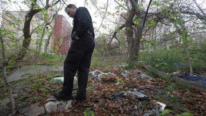 Rob Sormani of the Westchester SPCA looks over the scene where 25 dead cats were found in Yonkers on  April 29, 2014.