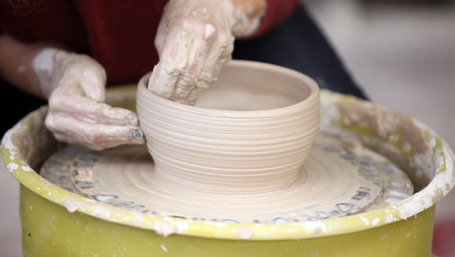 A volunteer creates a bowl on Jan. 5, 2013, at Clay Art Center in Port Chester.