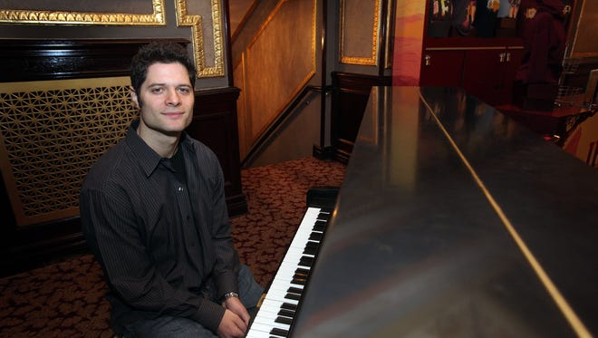 Pulitzer Prize and Tony winner Tom Kitt, who grew up in Armonk, is photographed at Richard Rodgers Theatre in Manhattan March 20, 2014.