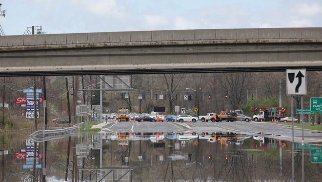 Cars are rerouted from Route 59 in West Nyack near Palisades Center due to flooding on May 1.