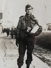 A photograph of Ret. Maj. George Mitchell, when he was in Berlin, Germany, is in a personal scrapbook at his home in Clemson. He will receive Purple Heart Sunday, 72 years after the injury, during a ceremony at Clemson Downs Retirement Home. Mitchell was wounded in Dec. 1944 at the Battle of Kesternich as Allied troops executed Battle of the Bulge in Germany.