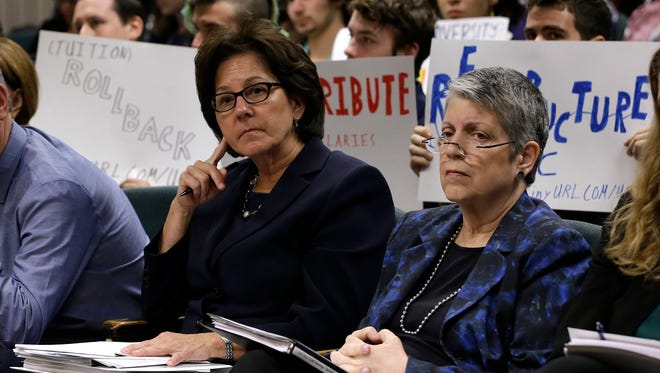 Monica Lozano, left, chair of the University of California Board of Regents, and UC President Janet Napolitano sit in the audience before appearing before the Joint Legislative Audit Committee recently in Sacramento.