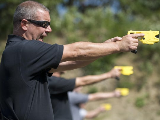 In this Sept. 25, 2012 file photo, Cherry Hill Township Police Officer Patrick Higgins takes part in a taser training session in Gloucester Township, N.J.