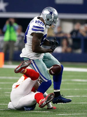 Dallas Cowboys wide receiver Dez Bryant (88) drops a pass as Kansas City Chiefs' Ron Parker (38) rolls onto Bryant's ankle in the second half of an NFL football game, Sunday, Nov. 5, 2017, in Arlington, Texas. (AP Photo/Michael Ainsworth)