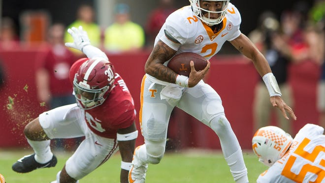 Tennessee quarterback Jarrett Guarantano (2) breaks free during Tennessee's game against Alabama at Bryant Denny Stadium in Tuscaloosa on Saturday, Oct. 21, 2017.