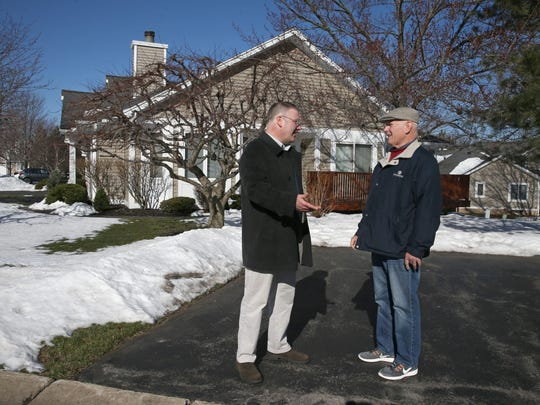 Dan Buccieri, Property Manager with Crofton Associates Inc., left, talks over tree care with Bill Knittle, association president at Edgewood Estates in Brighton, Thursday, March 23, 2017.