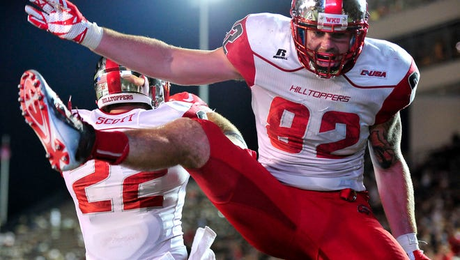 Western Kentucky tight end Tyler Higbee (82) celebrates with tight end Devin Scott (22) after scoring a touchdown against Vanderbilt during the fourth quarter of an NCAA college football game in Nashville, Tenn., Thursday, Sept. 3, 2015. Western Kentucky won 14-12. (Jae S. Lee / The Tennessean via AP)