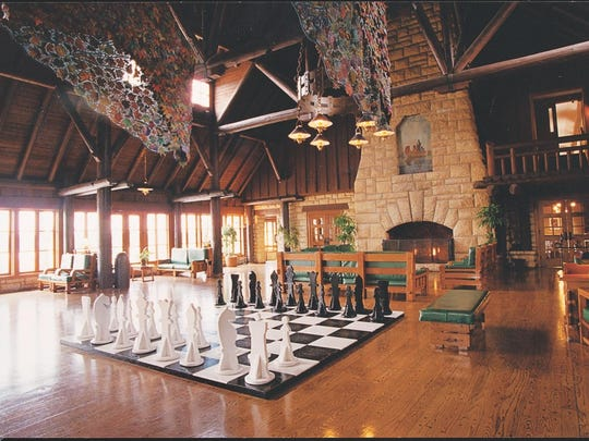 A 50-foot-tall stone fireplace and human-sized chess set are inside the lodge at Pere Marquette State Park.