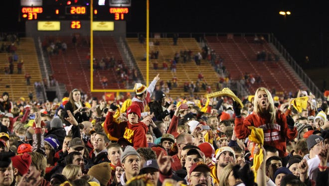 Iowa State fans celebrate the 37-31 double overtime victory over Oklahoma State at Jack Trice Stadium in Ames, Iowa, on Friday Nov. 18, 2011.